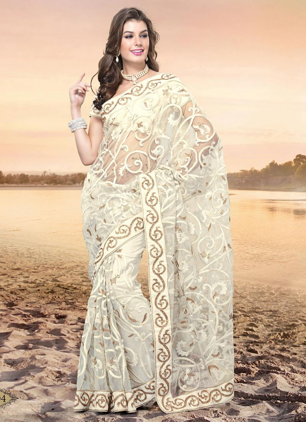 Beguiling Cream Embroidered Net Saree
