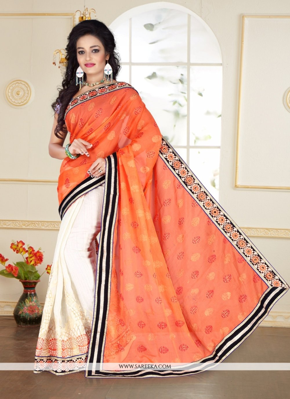 Beguiling Off White and Peach Georgette Designer Saree
