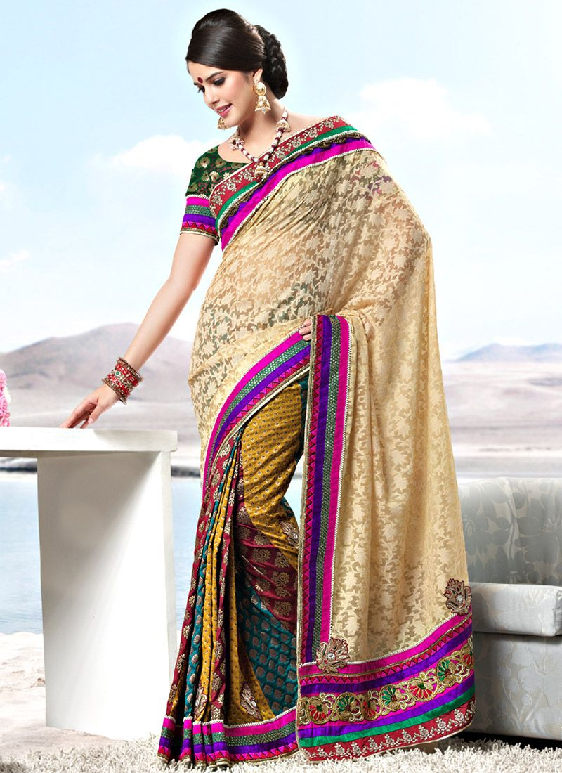 Cream and Multicolour Net and Viscose Saree