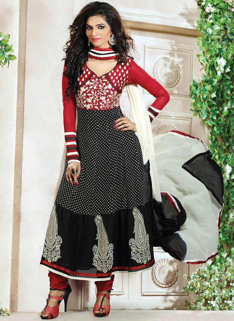 Evocative Black And Red Printed Tiered Churidar Suit