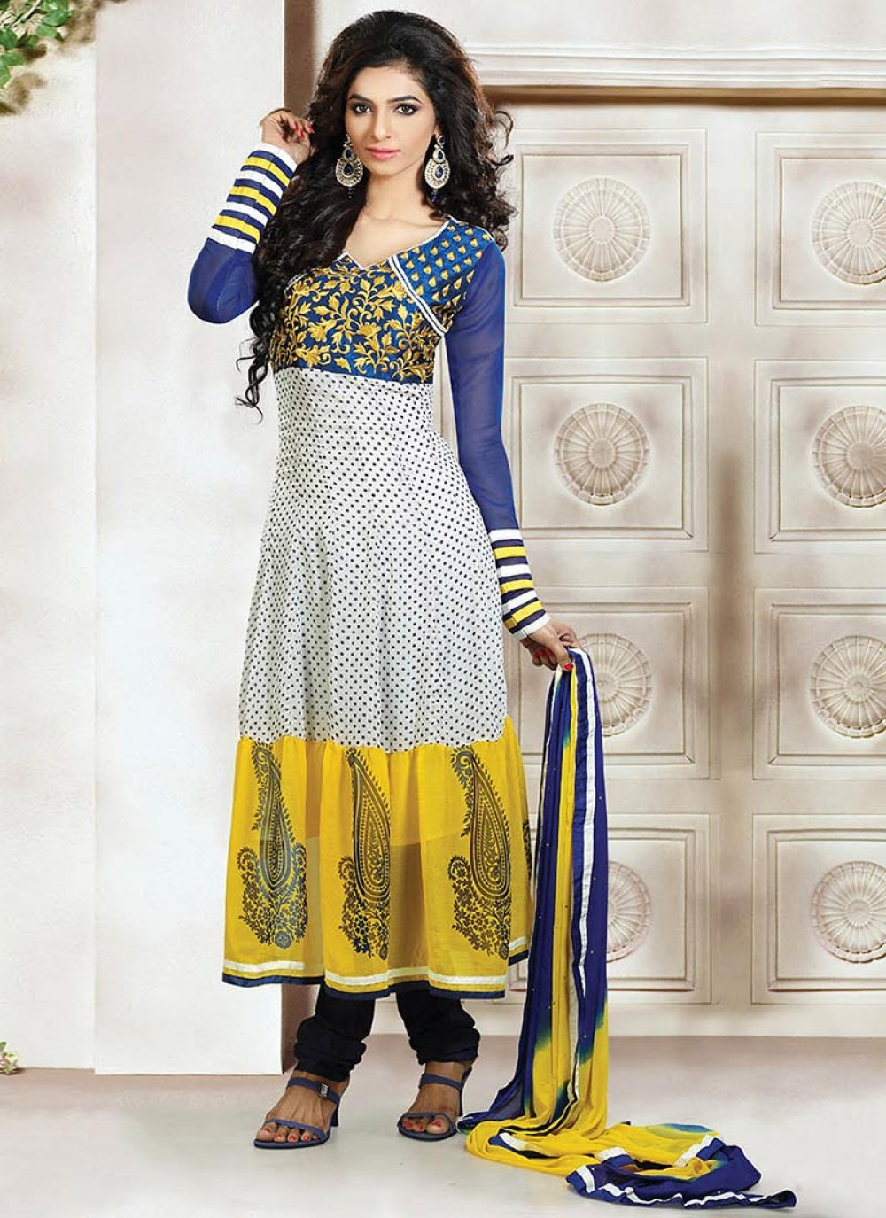 Extravagant Yellow And White Printed Tiered Churidar Suit