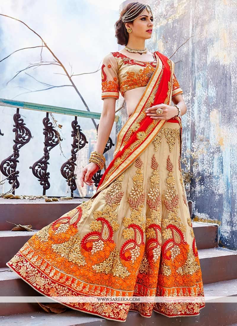 Beige And Orange Net Lehenga Choli