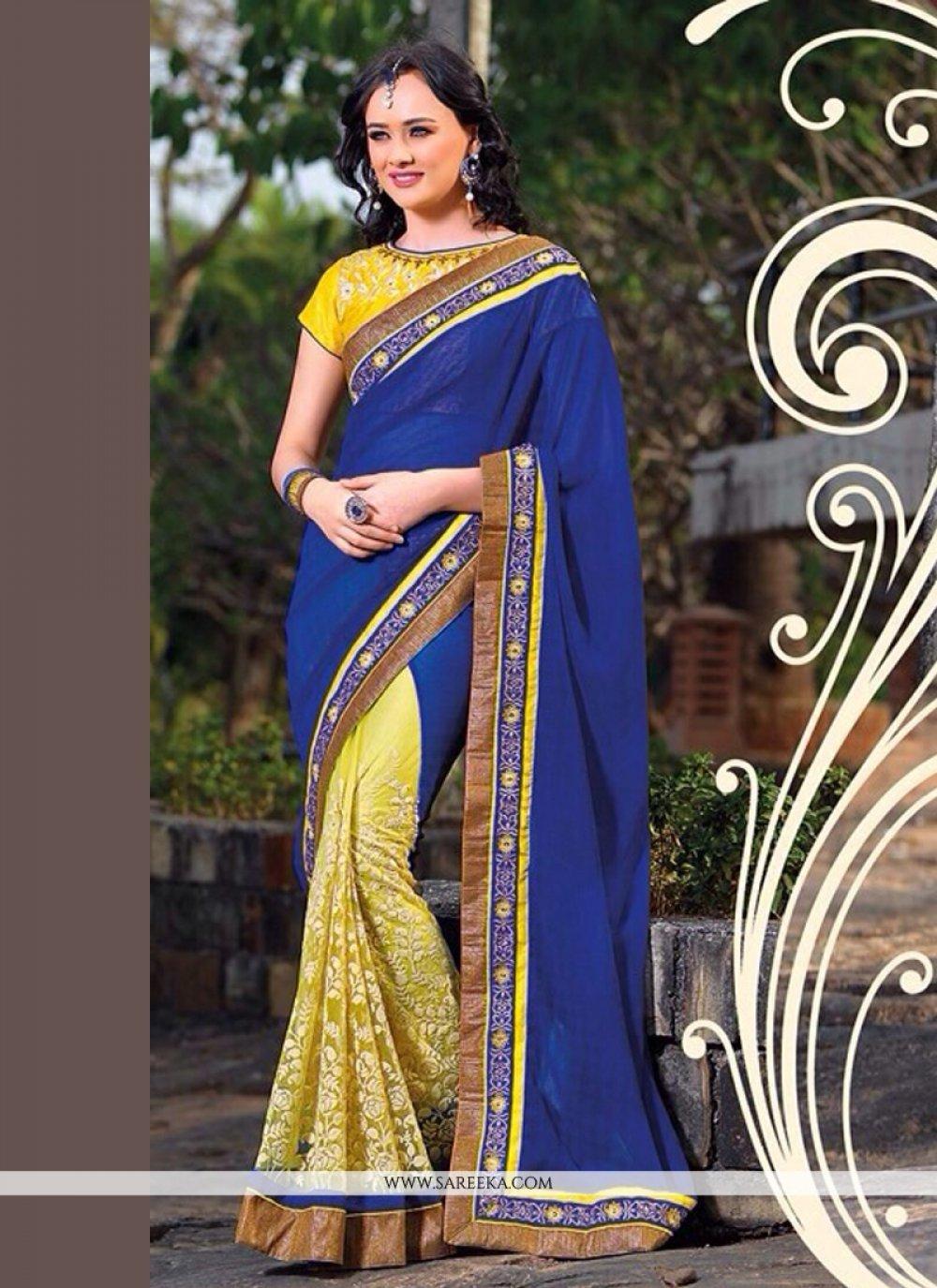 Fabulose Blue And Yellow Net Designer Saree