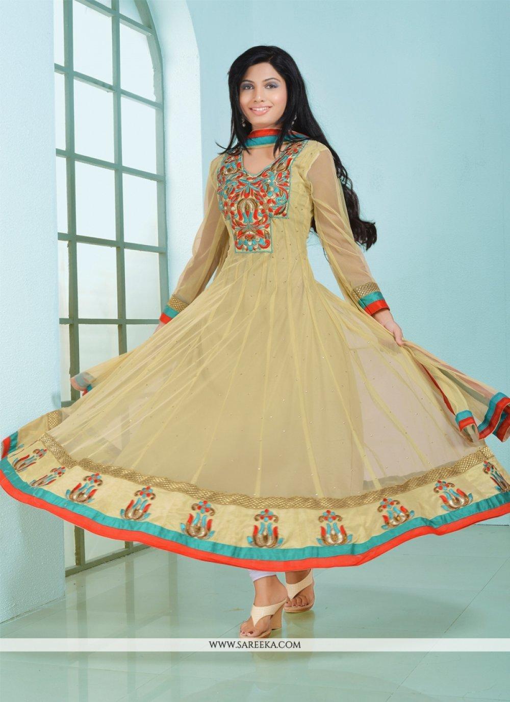 Fabulose Cream Net Anarkali Suit