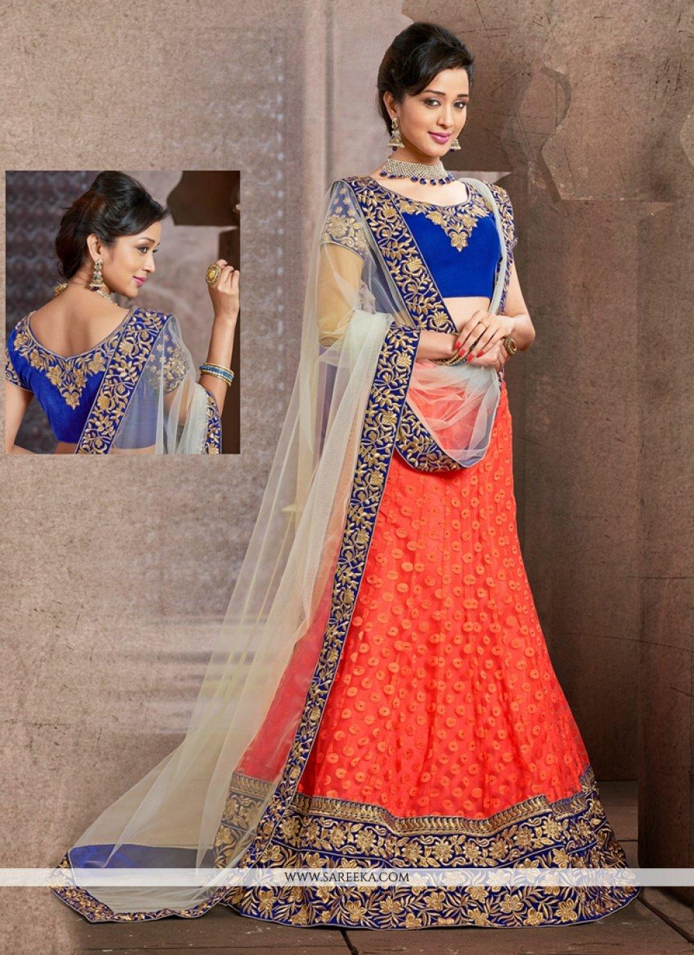 Fabulose Orange Net Wedding Lehenga Choli