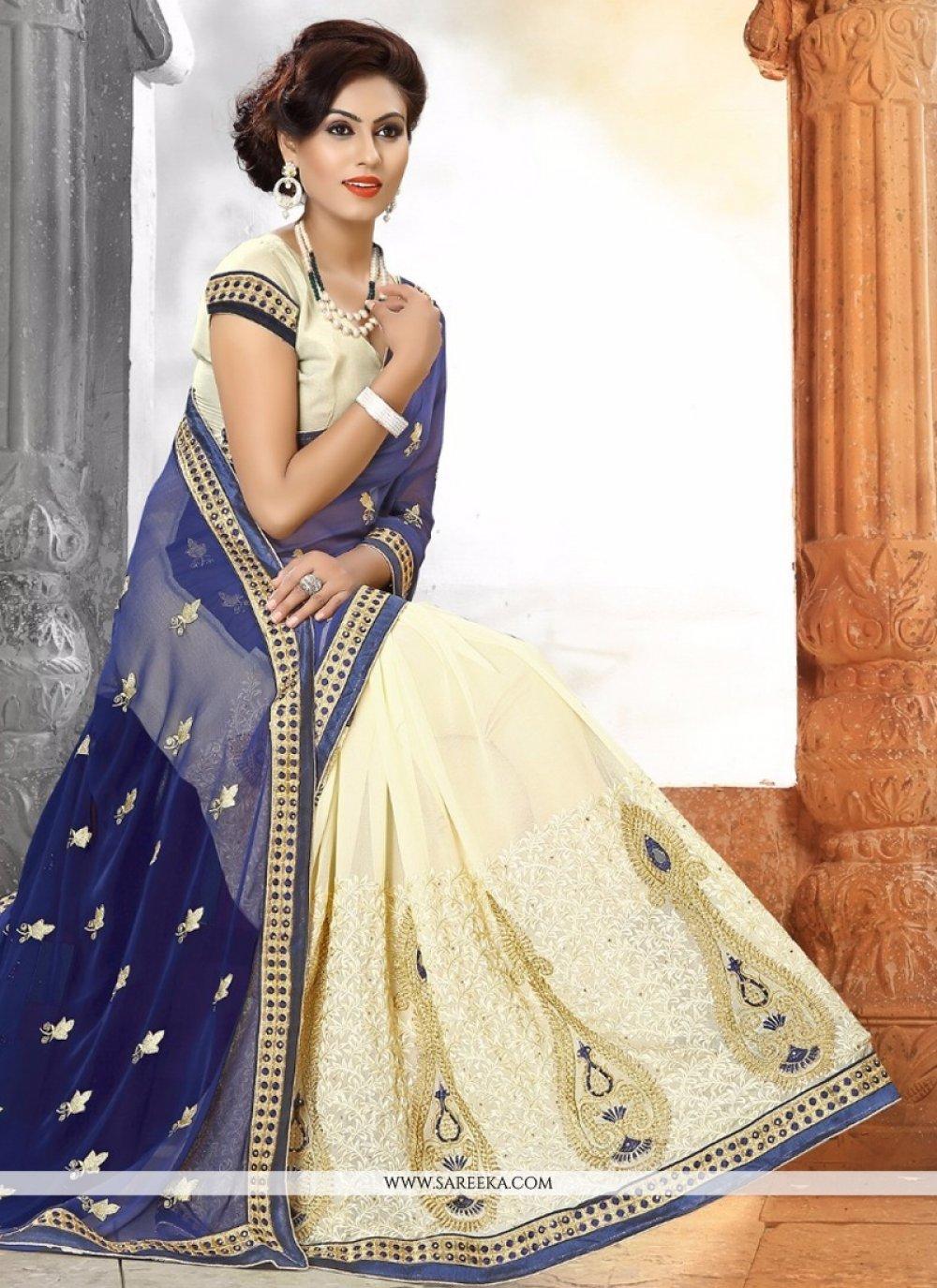 Cream and Blue Zari Work Georgette Designer Saree