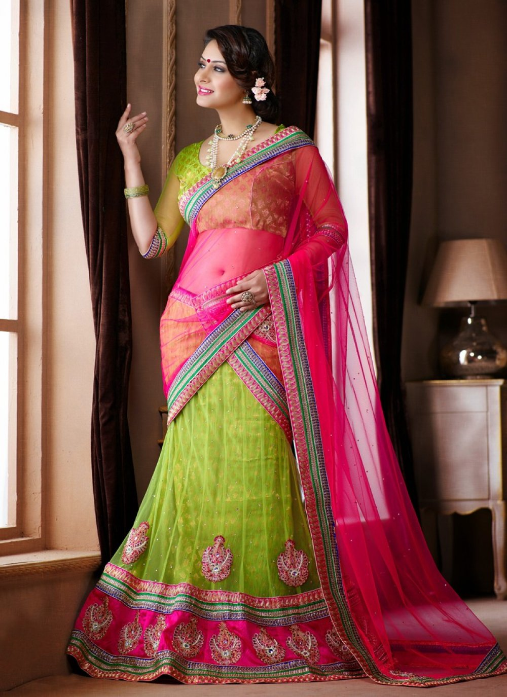 Green And Pink Patch Border Work Net Lehenga Choli