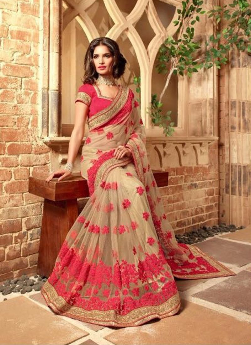 gripping embroidered work beige designer bridal sarees
