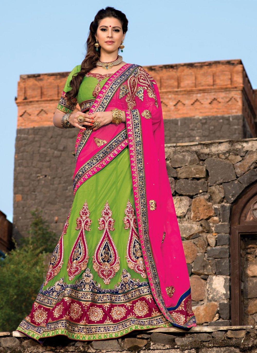 Lustrous Green Net Stone Wedding Lehenga Choli