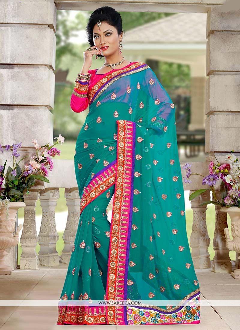 Lustrous Teal Green Georgette Designer Saree