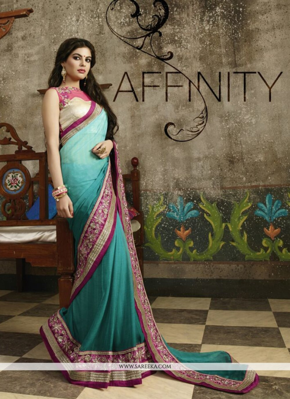 Fancy Fabric Teal Embroidered Work Designer Saree