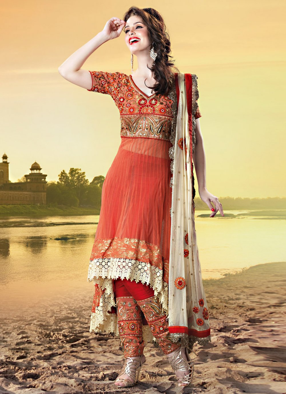 Orange Shade Net Churidar Suit
