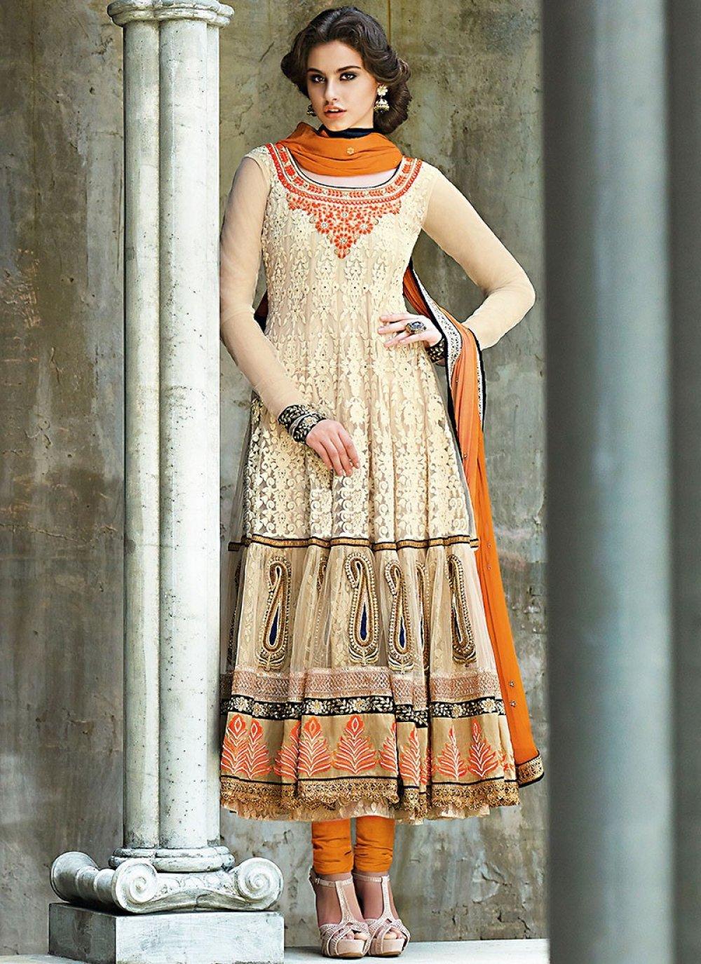 Seductive Cream And Orange Net Anarkali Suit