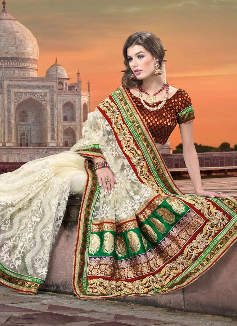 Sizzling Pale Cream Embroidered Net Saree