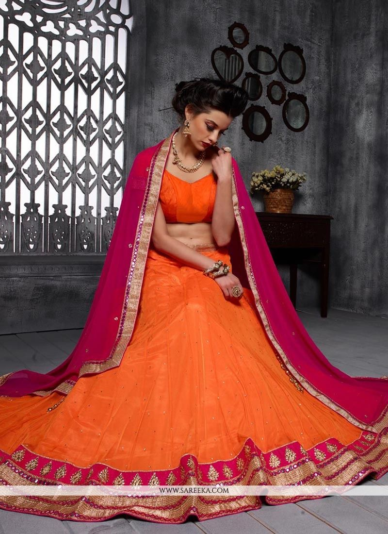 Orange Patch Border Work Net A Line Lehenga Choli