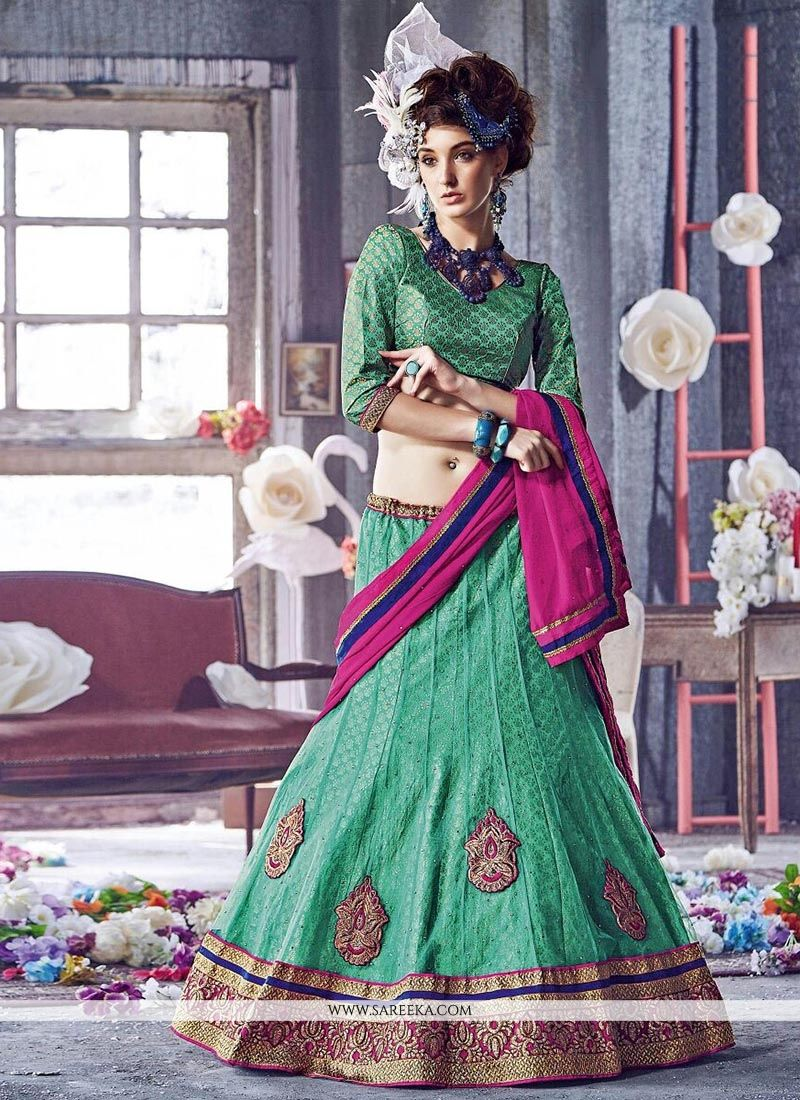 Sea Green Patch Border Work Net A Line Lehenga Choli