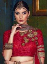 Fancy Fabric Cream and Red Lehenga Choli
