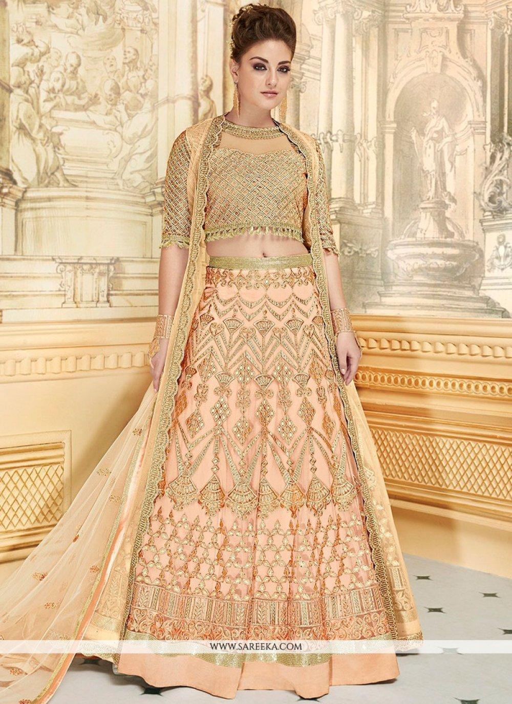 Fancy Fabric Peach Lace Work Lehenga Choli