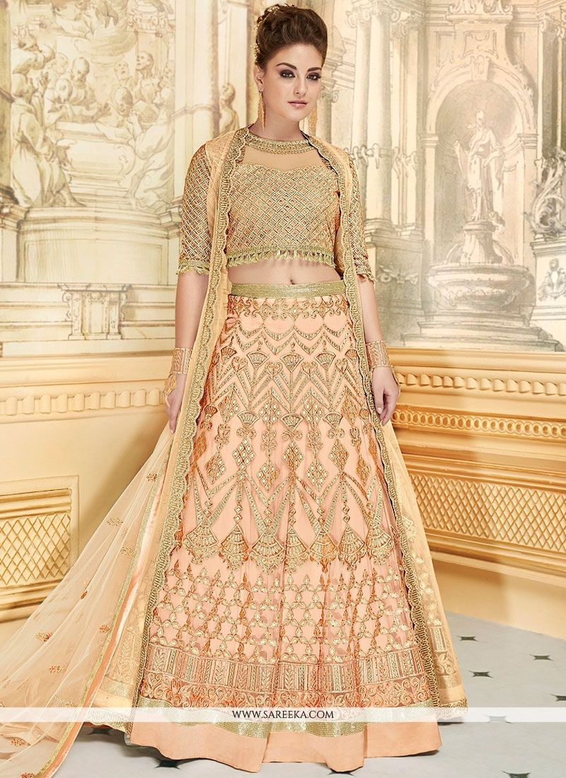 Fancy Fabric Peach Lace Work Lehenga Choli