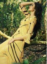 Faux Georgette Party Wear Kurti in Yellow