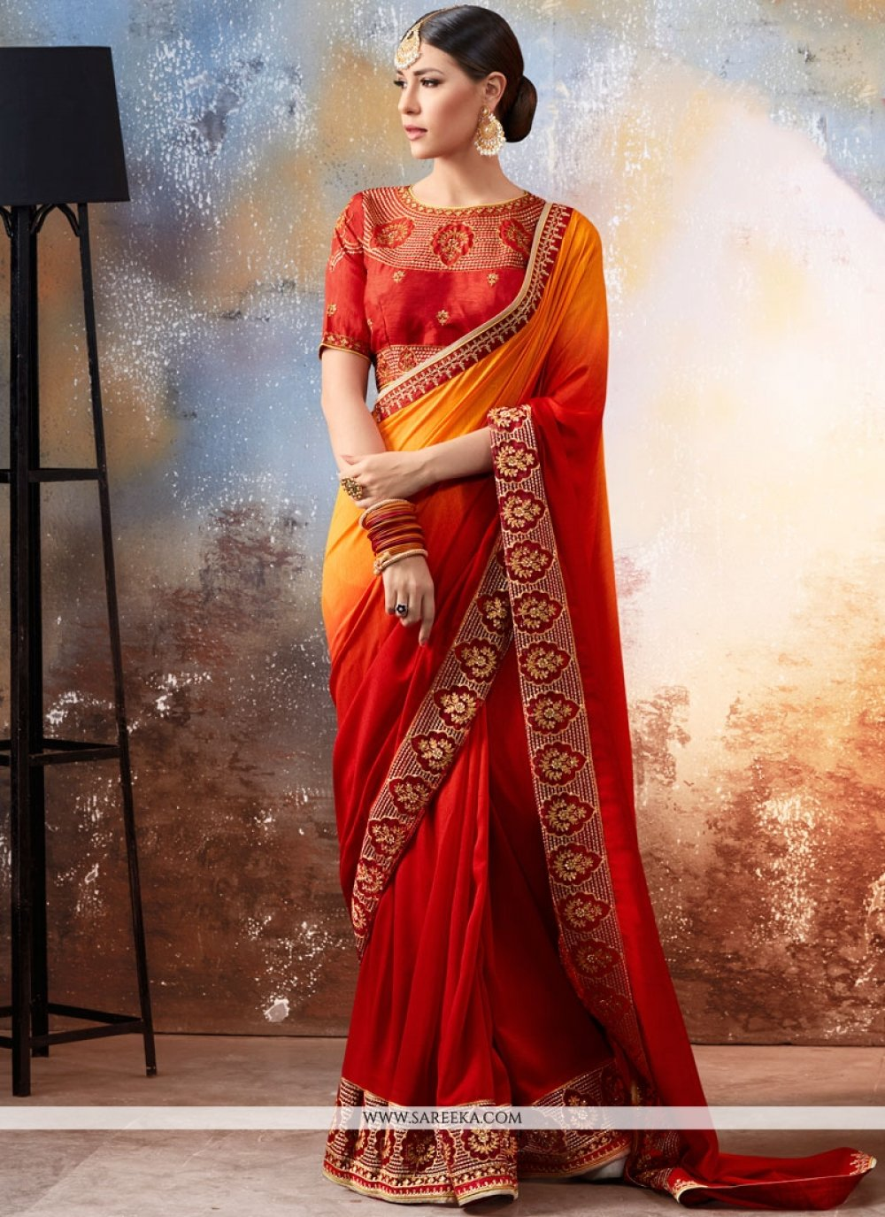 Orange and Red Faux Georgette Shaded Saree