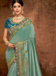 Art Silk Teal Embroidered Traditional Designer Saree