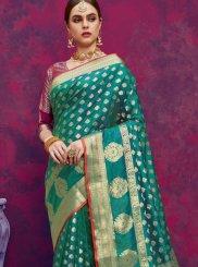 Banarasi Silk Teal Weaving Classic Designer Saree