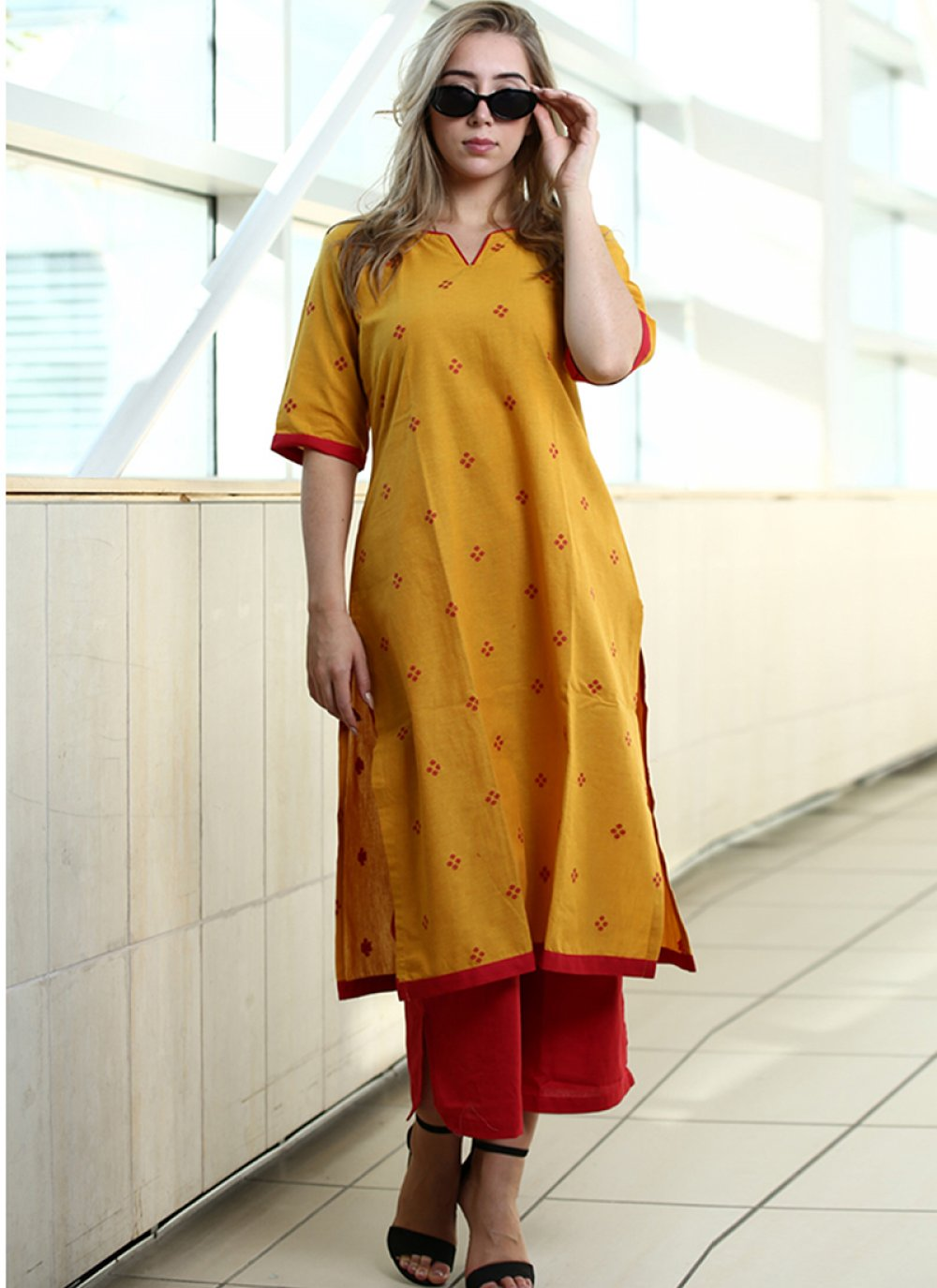 Cotton Printed Party Wear Kurti in Yellow