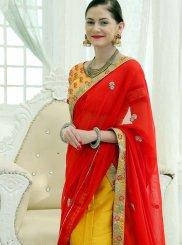 Fancy Fabric Yellow Embroidered Lehenga Choli