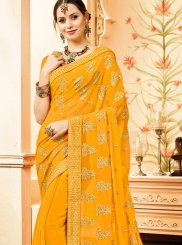 Faux Georgette Classic Saree in Yellow