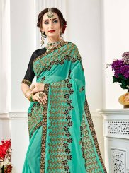 Faux Georgette Embroidered Saree in Blue