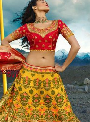 Jacquard Silk Red and Yellow Zari Lehenga Choli