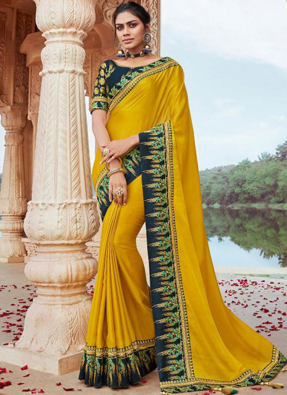 Embroidered Faux Georgette Classic Saree in Yellow