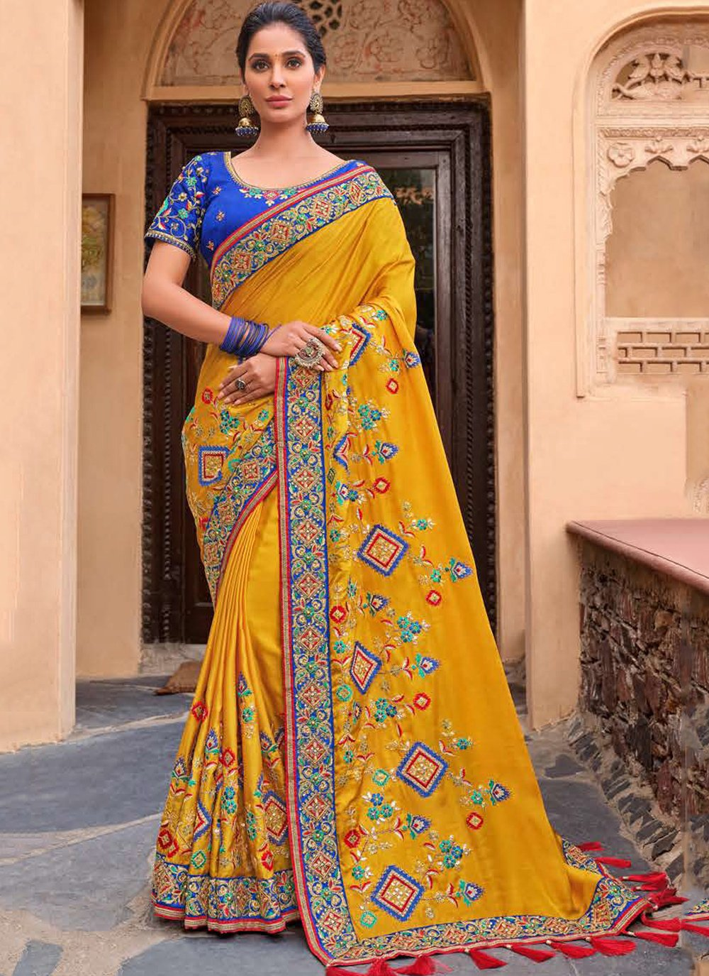 Embroidered Yellow Georgette Traditional Saree