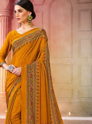 Faux Crepe Printed Saree in Mustard