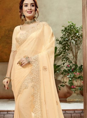 Faux Georgette Designer Traditional Saree in Cream