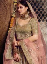 Net Embroidered Bollywood Lehenga Choli in Gold
