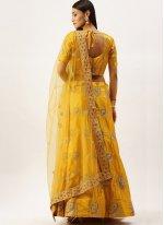 Embroidered Satin Silk Lehenga Choli in Yellow