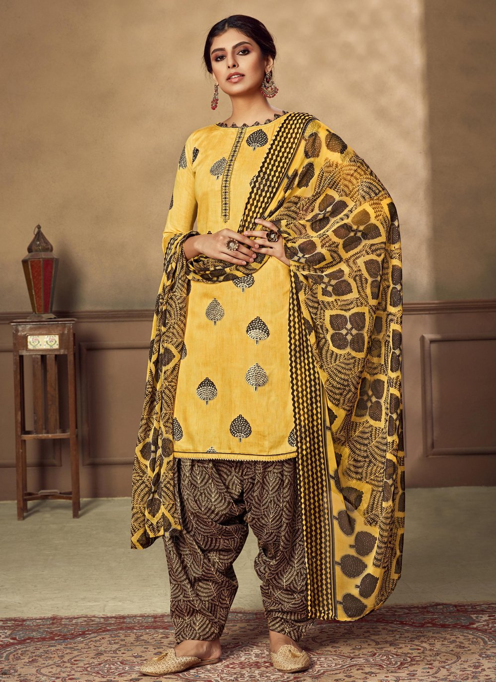 Fancy Fabric Yellow Designer Patiala Suit