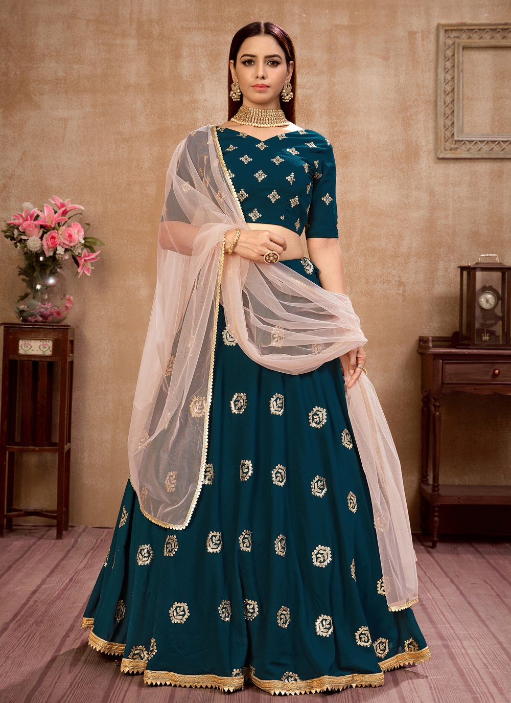 Faux Georgette Teal Sequins Lehenga Choli