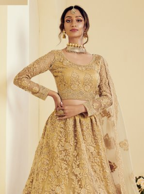 Net Stone Work Lehenga Choli in Gold